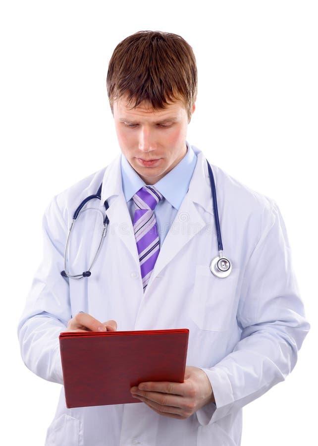 αρσενικό γράψιμο γιατρών στοκ φωτογραφίες