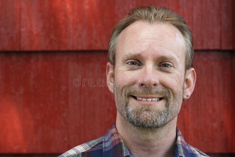 Αρσενικό χαμόγελο στοκ εικόνες