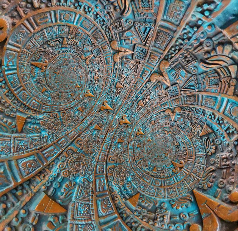 Αρχαίο παλαιό κλασσικό διπλό σπειροειδές των Αζτέκων υπόβαθρο σχεδίου διακοσμήσεων σχεδίων διακοσμήσεων χαλκού Αφηρημένο fractal  στοκ φωτογραφία