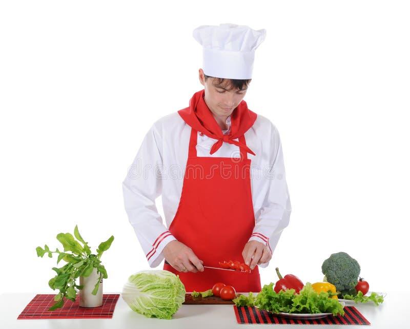 Αρχιμάγειρας και ντομάτα στο μαχαίρι. στοκ φωτογραφίες