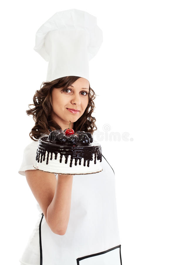 Αρχιμάγειρας με το κέικ σοκολάτας στοκ φωτογραφία