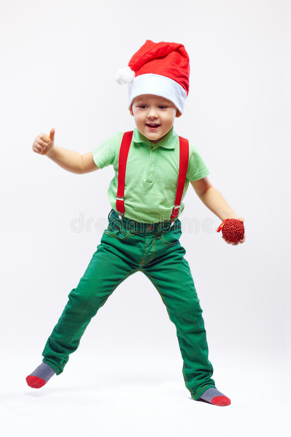 Αρωγός του χαριτωμένου santa που χορεύει στο λευκό στοκ εικόνα με δικαίωμα ελεύθερης χρήσης