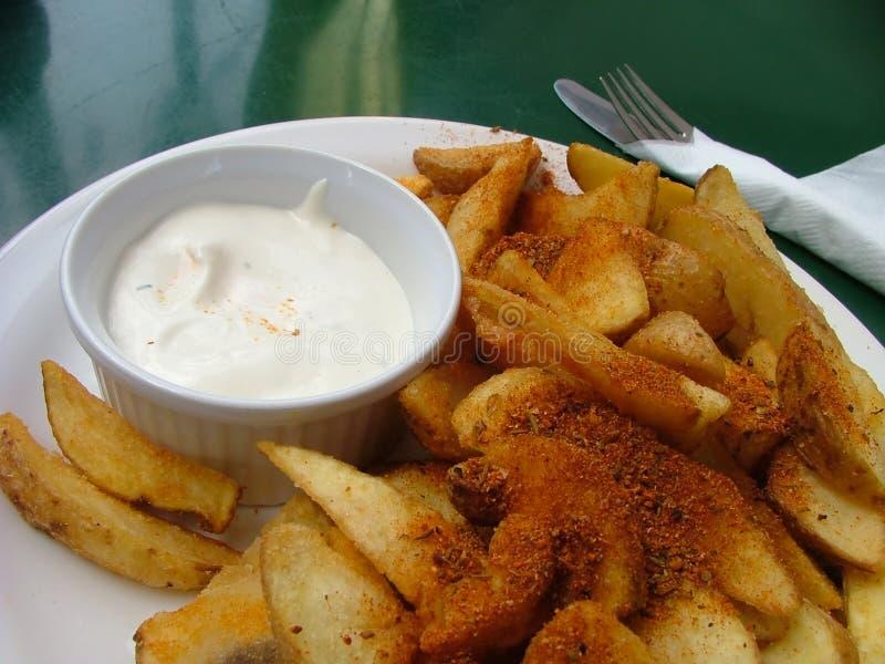 αρωματικές potatoe φέτες στοκ εικόνα