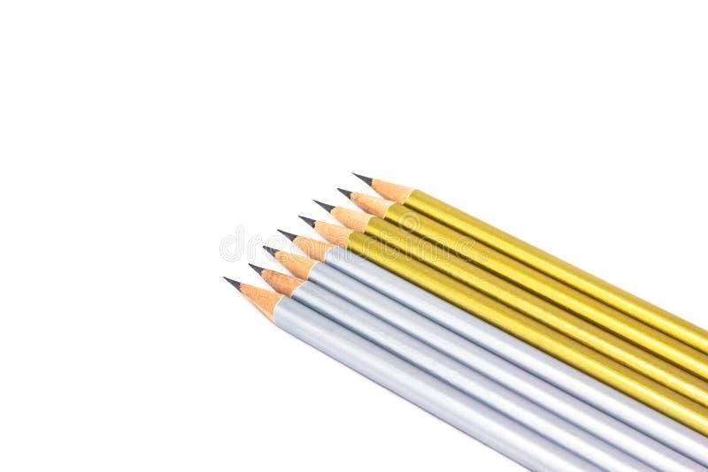 Ασημένιο και χρυσό μολύβι που απομονώνεται στο καθαρό άσπρο υπόβαθρο στοκ εικόνες