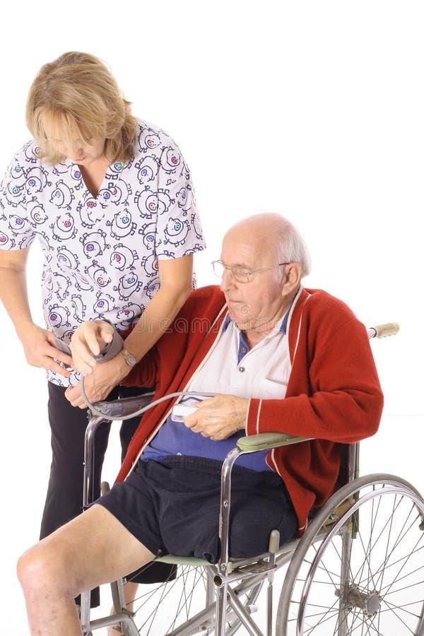 ασθενής νοσοκόμων αναπηρίας στοκ φωτογραφία