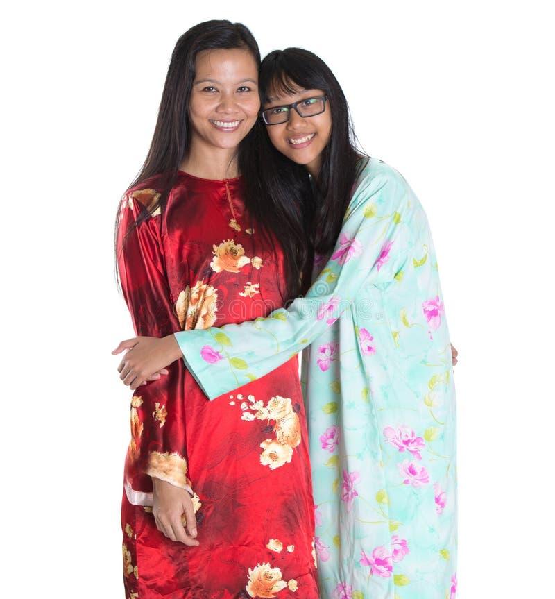 Ασιατικά της Μαλαισίας μητέρα και έφηβη κόρη ΙΙΙ στοκ εικόνες