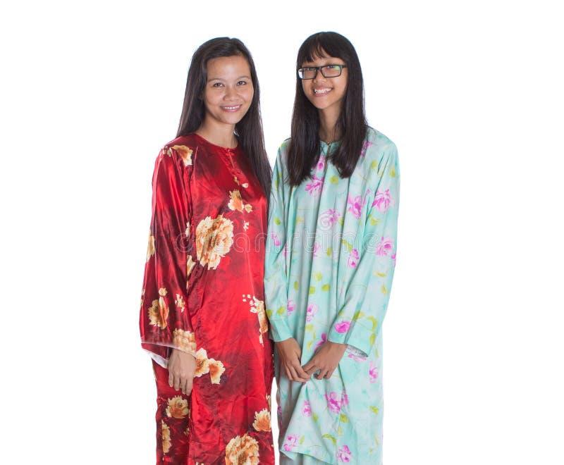 Ασιατικά της Μαλαισίας μητέρα και έφηβη κόρη Ι στοκ εικόνες