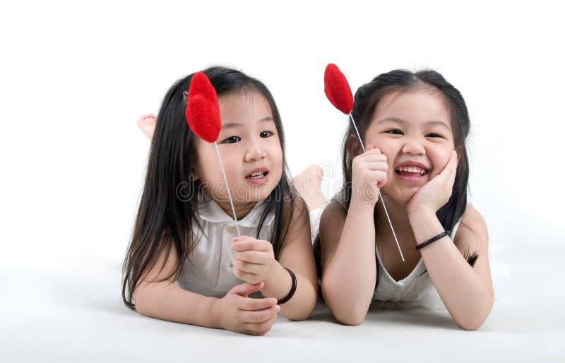 ασιατικά χαριτωμένα κορίτ&sig στοκ εικόνα με δικαίωμα ελεύθερης χρήσης