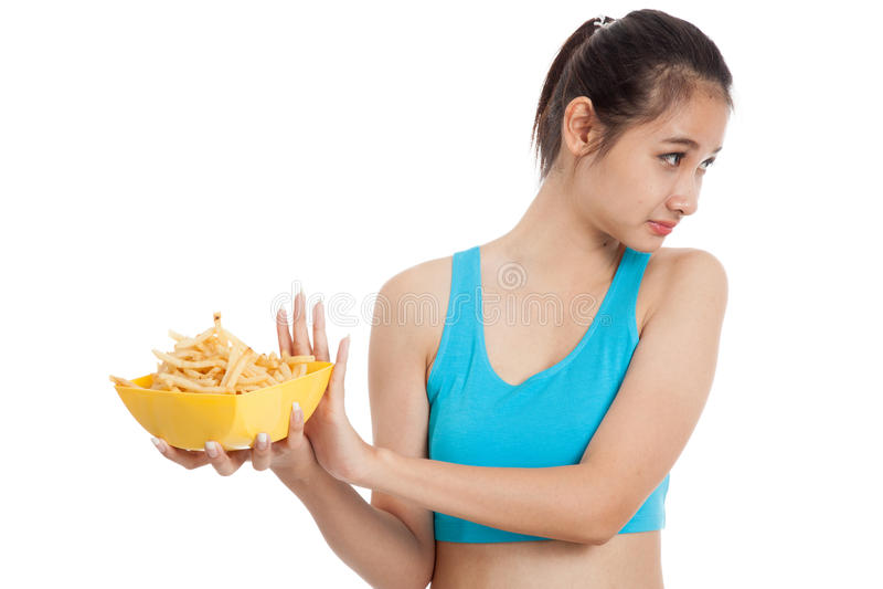 Ασιατικές υγιείς τηγανιτές πατάτες μίσους κοριτσιών, άχρηστο φαγητό στοκ εικόνα με δικαίωμα ελεύθερης χρήσης