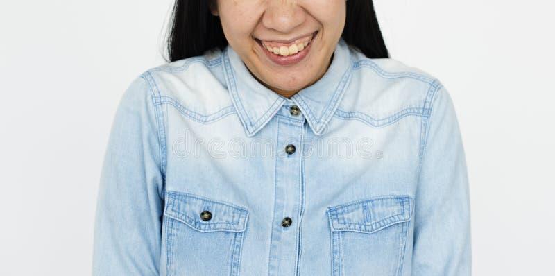 Ασιατική γυναικών χαμόγελου έννοια προσώπου πορτρέτου μισή στοκ εικόνες
