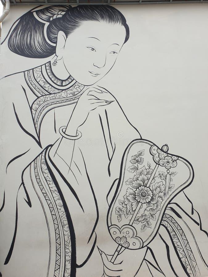 Ασιατική κυρία που κρατά έναν ανεμιστήρα στοκ φωτογραφία