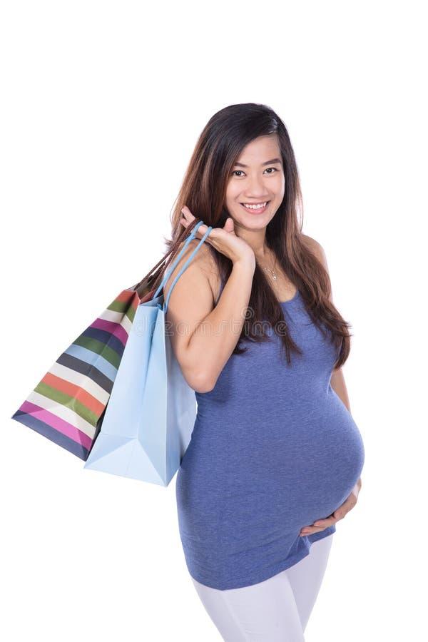 Ασιατική τσάντα εγγράφου εκμετάλλευσης εγκύων γυναικών στοκ φωτογραφία