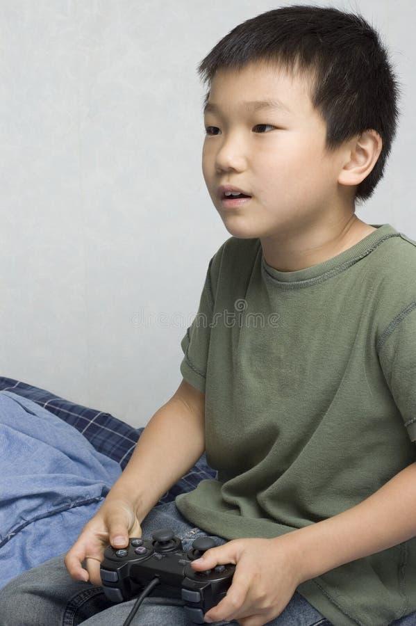 ασιατικό αγόρι gamer στοκ εικόνα