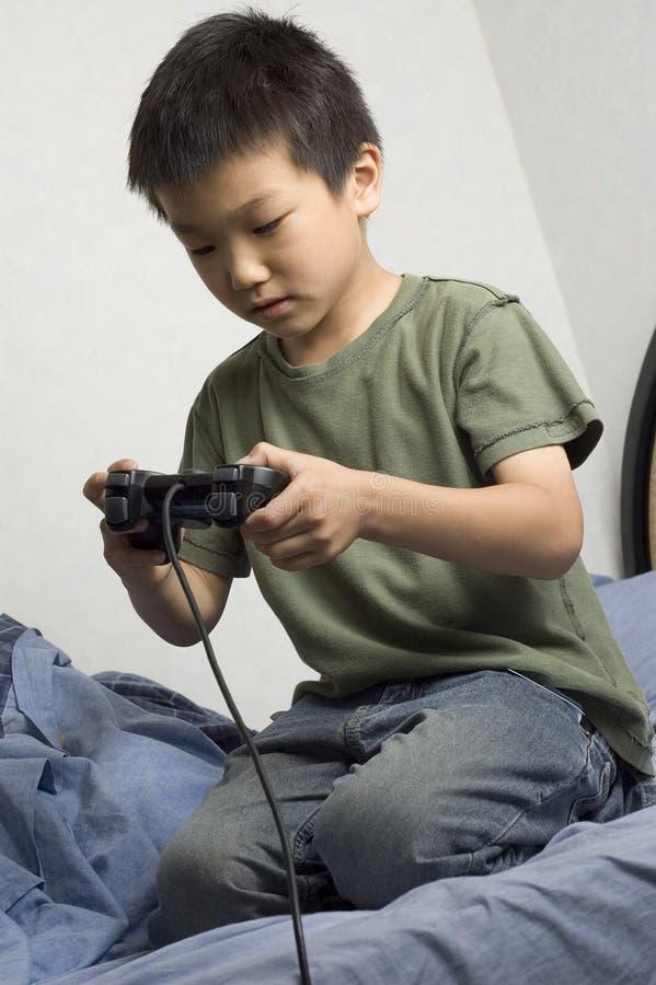 ασιατικό αγόρι gamer στοκ φωτογραφία