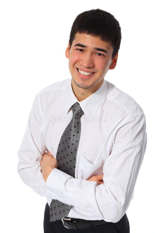 ασιατικό πουκάμισο επιχειρηματιών που χαμογελά τις λευκές νεολαίες στοκ εικόνες