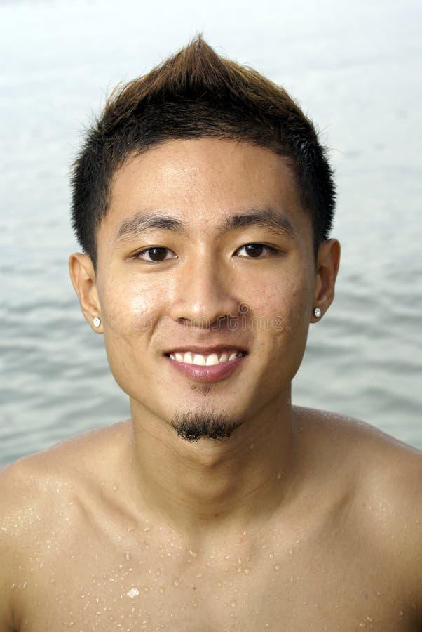 ασιατικό χαμόγελο ατόμων παραλιών στοκ φωτογραφία με δικαίωμα ελεύθερης χρήσης