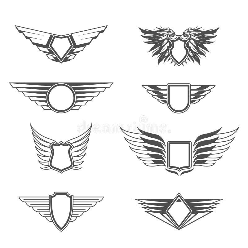 Ασπίδες με τα πρότυπα φτερών διανυσματική απεικόνιση