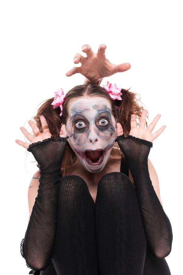 Αστεία γυναίκα με το ανατριχιαστικό makeup στοκ εικόνες
