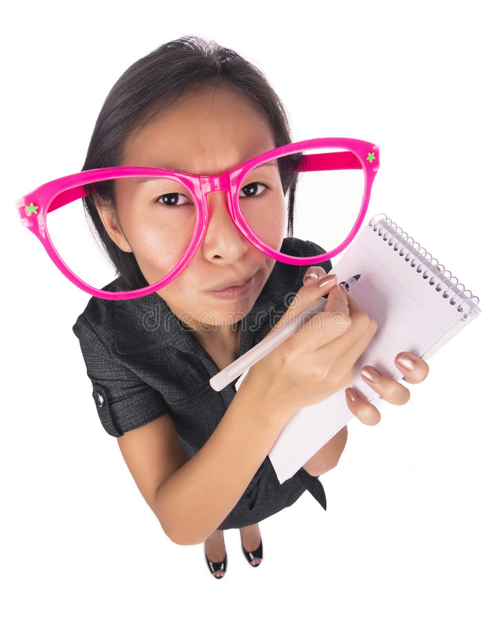 Αστεία γυναίκα που παίρνει τις σημειώσεις στοκ φωτογραφίες