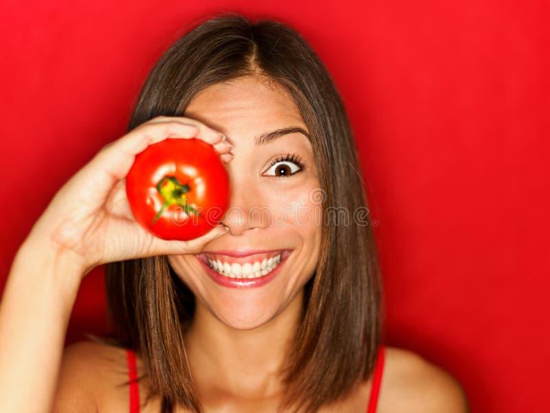 αστεία κόκκινη γυναίκα ντοματών τροφίμων στοκ εικόνα