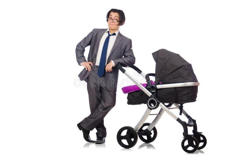 Αστείος μπαμπάς με το μωρό και καροτσάκι στο λευκό στοκ φωτογραφία με δικαίωμα ελεύθερης χρήσης
