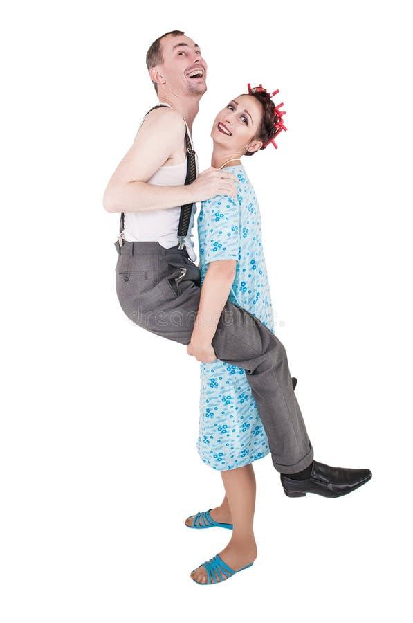 Αστείο οικογενειακό ζεύγος που έχει τη διασκέδαση απομονωμένη στοκ εικόνες με δικαίωμα ελεύθερης χρήσης