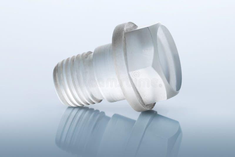Ασυνήθιστο μπουλόνι φιαγμένο από διαφανές πλαστικό στοκ φωτογραφίες