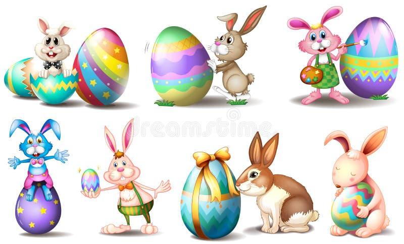 Αυγά Πάσχας με τα εύθυμα λαγουδάκια ελεύθερη απεικόνιση δικαιώματος