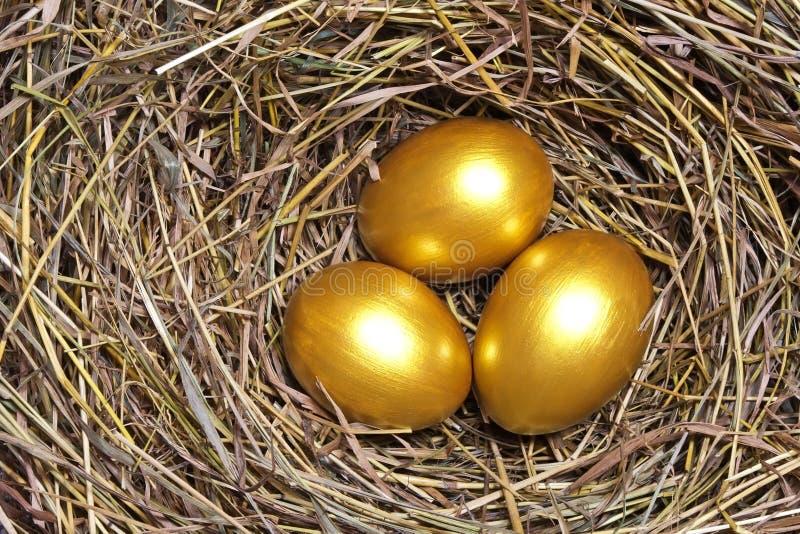 αυγά χρυσά τρία στοκ φωτογραφία με δικαίωμα ελεύθερης χρήσης