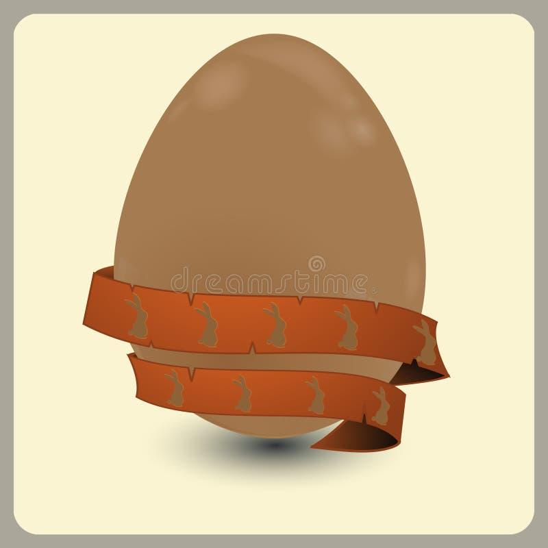Αυγό Πάσχας σοκολάτας με το έμβλημα και τα λαγουδάκια ελεύθερη απεικόνιση δικαιώματος