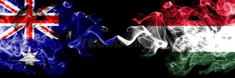 Αυστραλία εναντίον της Ουγγαρίας, ουγγρικές καπνώείς απόκρυφες σημαίες που τοποθετούνται δίπλα-δίπλα Πυκνά χρωματισμένος μεταξωτό στοκ φωτογραφία με δικαίωμα ελεύθερης χρήσης
