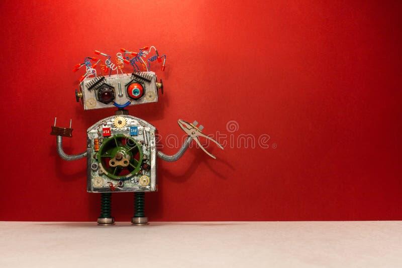 Αφίσα με ρομποτικό handyman για το σχέδιο εμβλημάτων υπηρεσιών συντήρησης επισκευής Ο ηλεκτρολόγος ρομπότ κρατά τις πένσες, κόκκι στοκ φωτογραφία με δικαίωμα ελεύθερης χρήσης