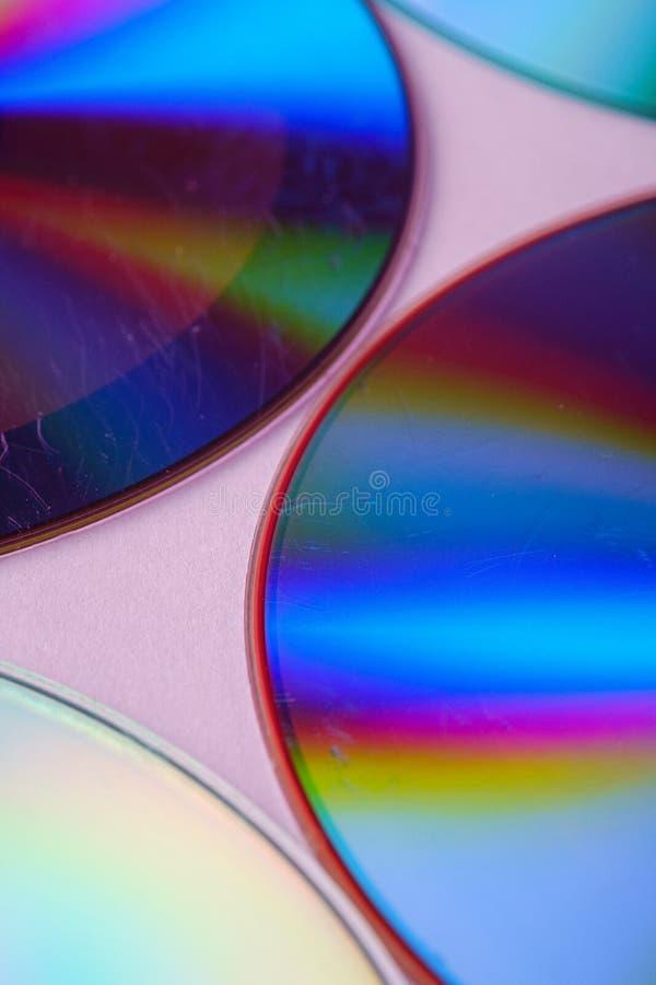 Αφηρημένη αντανάκλαση διάθλασης διασποράς δίσκων CD του CD DVD της ελαφριάς σύστασης χρωμάτων ρόδινο στενό σε επάνω υποβάθρου στοκ φωτογραφίες με δικαίωμα ελεύθερης χρήσης