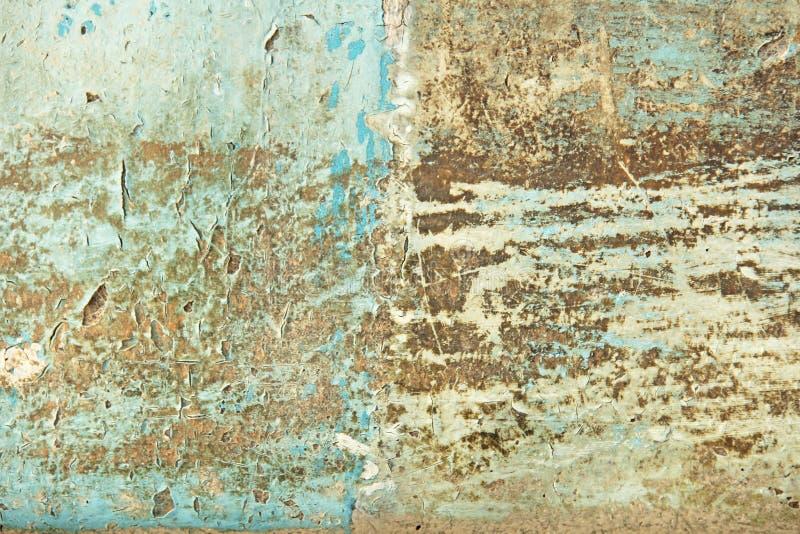 Αφηρημένη μπλε, μπεζ και τυρκουάζ σύσταση ταπετσαριών υποβάθρου Παλαιά λεπιοειδής αποφλοίωση χρωμάτων από το βρώμικο ραγισμένο το στοκ φωτογραφίες με δικαίωμα ελεύθερης χρήσης