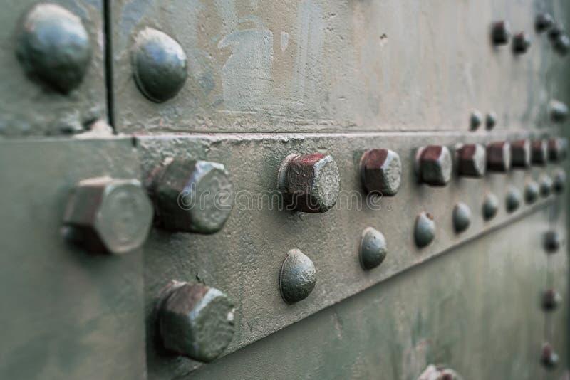 Αφηρημένη πράσινη βιομηχανική σύσταση υποβάθρου μετάλλων με τα μπουλόνια στοκ εικόνα