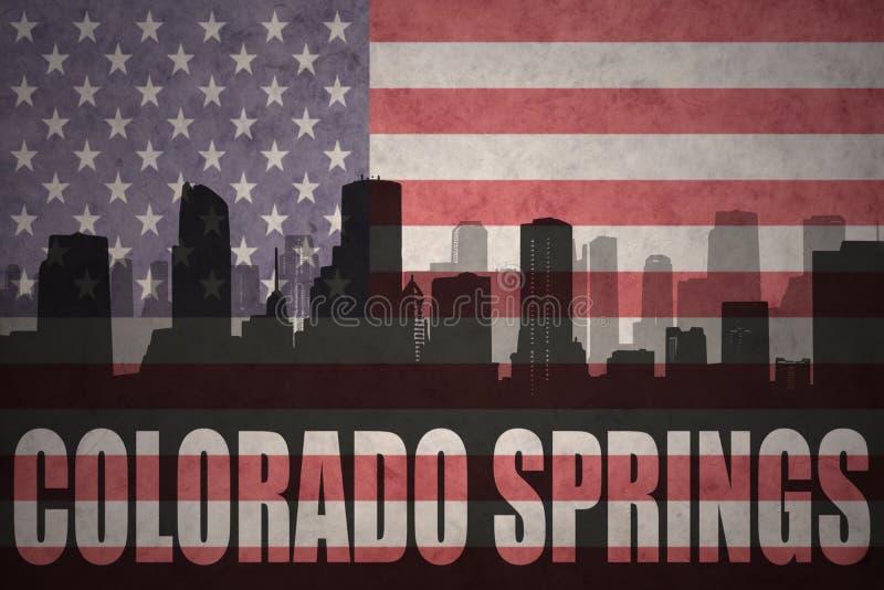 Αφηρημένη σκιαγραφία της πόλης με το κείμενο Colorado Springs στην εκλεκτής ποιότητας αμερικανική σημαία απεικόνιση αποθεμάτων