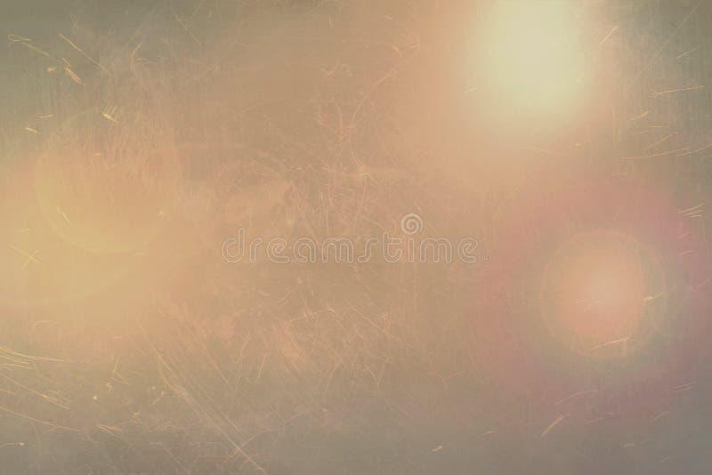 Αφηρημένο γκρίζο υπόβαθρο με τις χρυσές λάμψεις Φορεμένη grunge σύσταση στοκ φωτογραφία