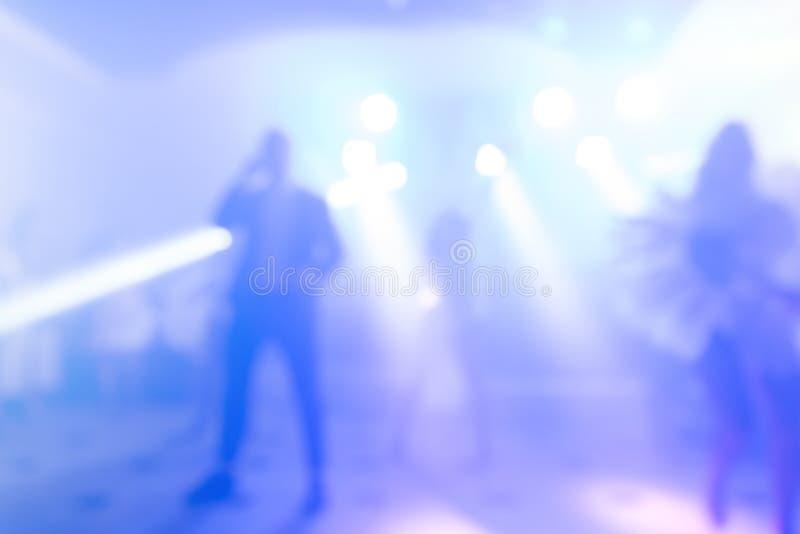 Αφηρημένο ζωηρόχρωμο υπόβαθρο για το σχέδιο Το κόμμα χορού στο νυχτερινό κέντρο διασκέδασης, παρουσιάζει, ανάβει επίκεντρα στοκ εικόνα