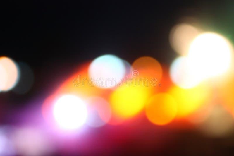 Αφηρημένο θολωμένο νύχτα bokeh υπόβαθρο φωτεινών σηματοδοτών πόλεων έξω στοκ εικόνα με δικαίωμα ελεύθερης χρήσης