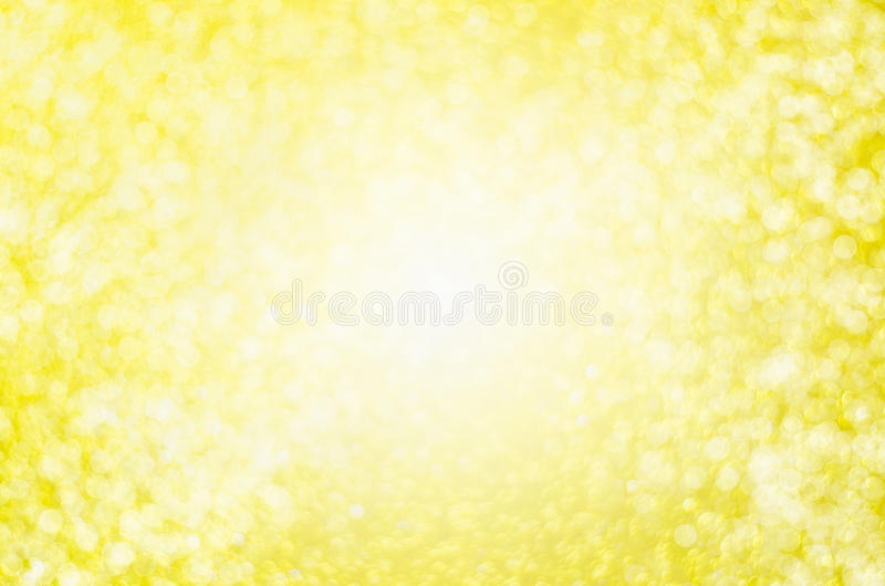 Αφηρημένο κίτρινο υπόβαθρο θαμπάδων - όμορφη ελαφριά χρυσή ΤΣΕ bokeh στοκ φωτογραφία
