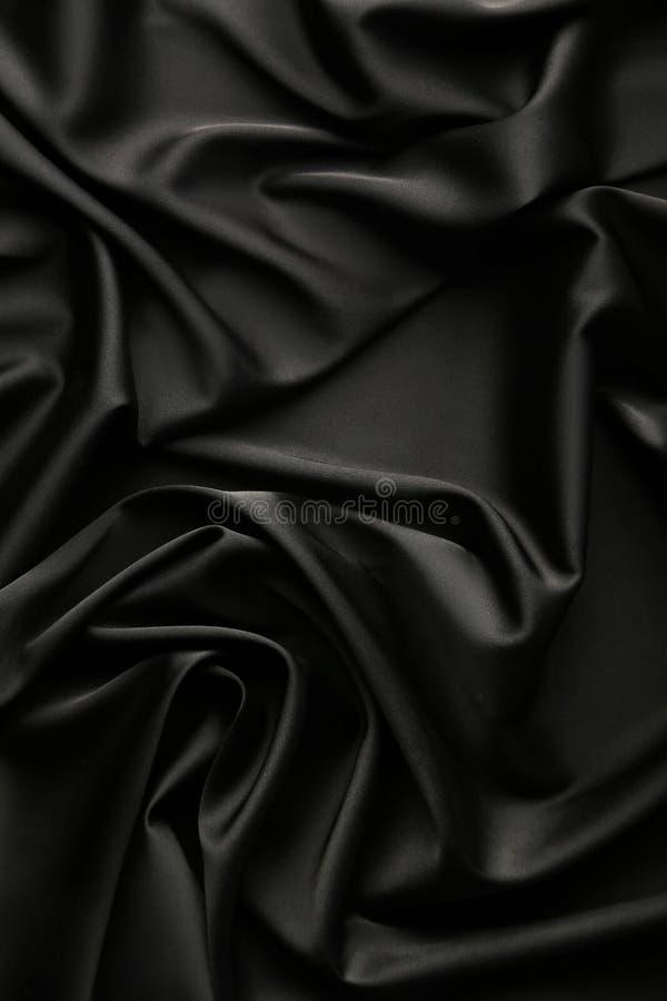 αφηρημένο σατέν υφάσματος ανασκόπησης μαύρο στοκ φωτογραφία με δικαίωμα ελεύθερης χρήσης