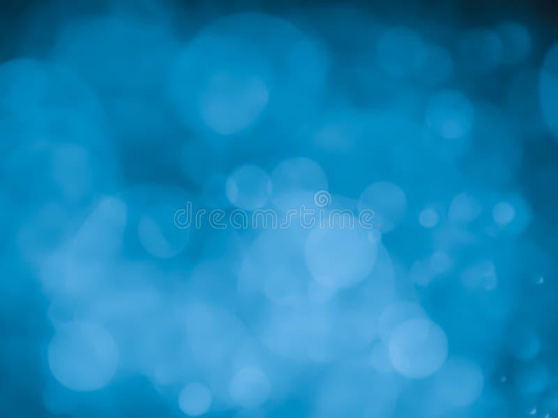 Αφηρημένο υπόβαθρο με τη φυσαλίδα bokeh στο μπλε χρώμα στοκ εικόνα