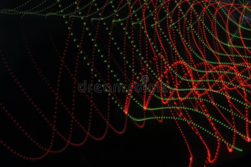 Αφηρημένο υπόβαθρο με τις γραμμές και τα σημεία στο κόκκινο και πράσινος στοκ εικόνες