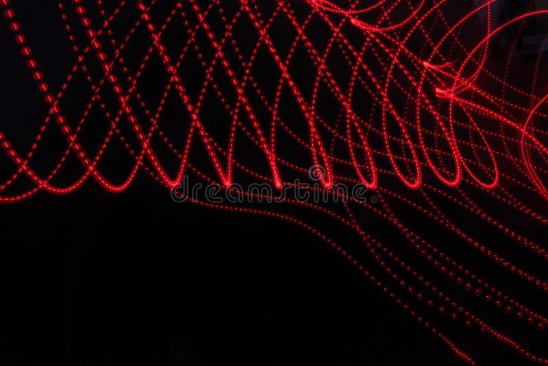 Αφηρημένο υπόβαθρο με τις γραμμές και τα σημεία στο κόκκινο στοκ φωτογραφία με δικαίωμα ελεύθερης χρήσης
