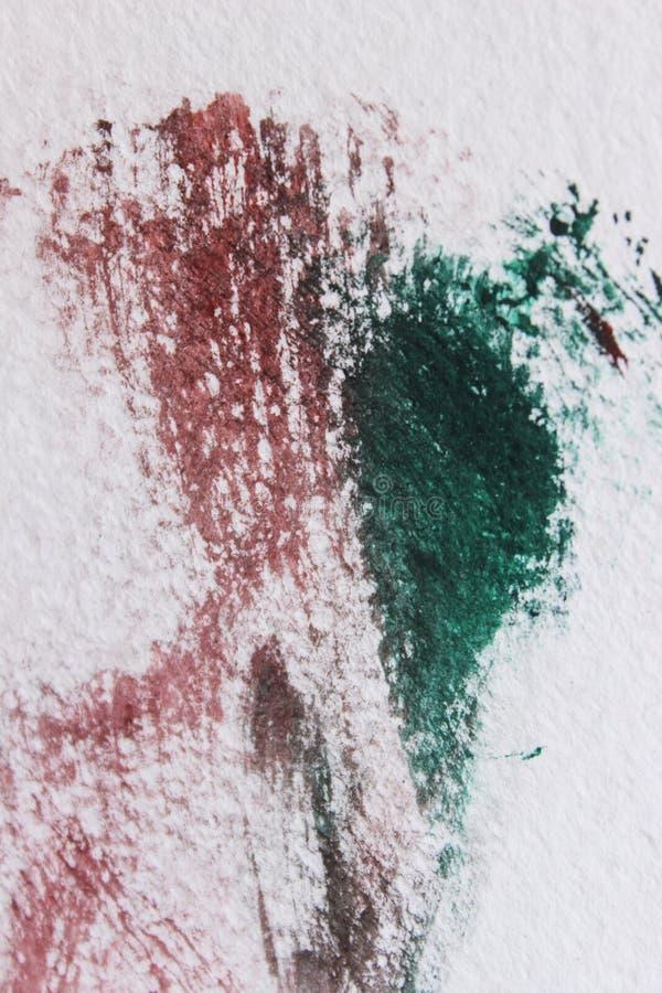 Αφηρημένο υπόβαθρο σε μια της υφής επιφάνεια στους πράσινους και κόκκινους τόνους ελεύθερη απεικόνιση δικαιώματος
