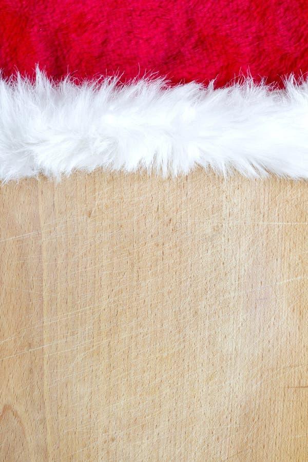 Αφηρημένο υπόβαθρο τροφίμων Χριστουγέννων με το καπέλο Άγιου Βασίλη στοκ φωτογραφία με δικαίωμα ελεύθερης χρήσης
