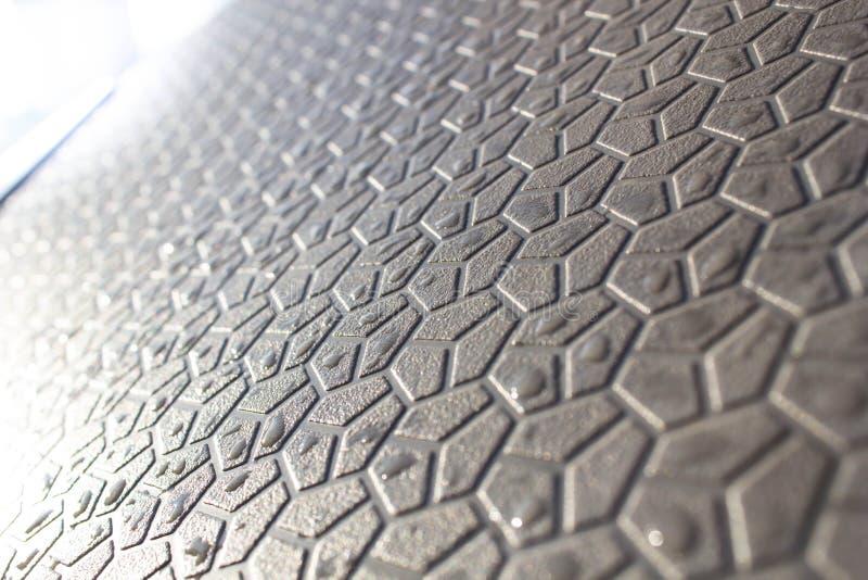 Αφηρημένο υπόβαθρο των γεωμετρικών μορφών, μορφές στο πεζοδρόμιο, ένα φουτουριστικό υπόβαθρο hexagons στοκ εικόνα