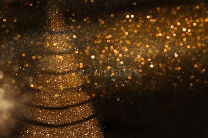 Αφηρημένο χρυσό και μαύρο υπόβαθρο φω'των Defocused στοκ εικόνες με δικαίωμα ελεύθερης χρήσης