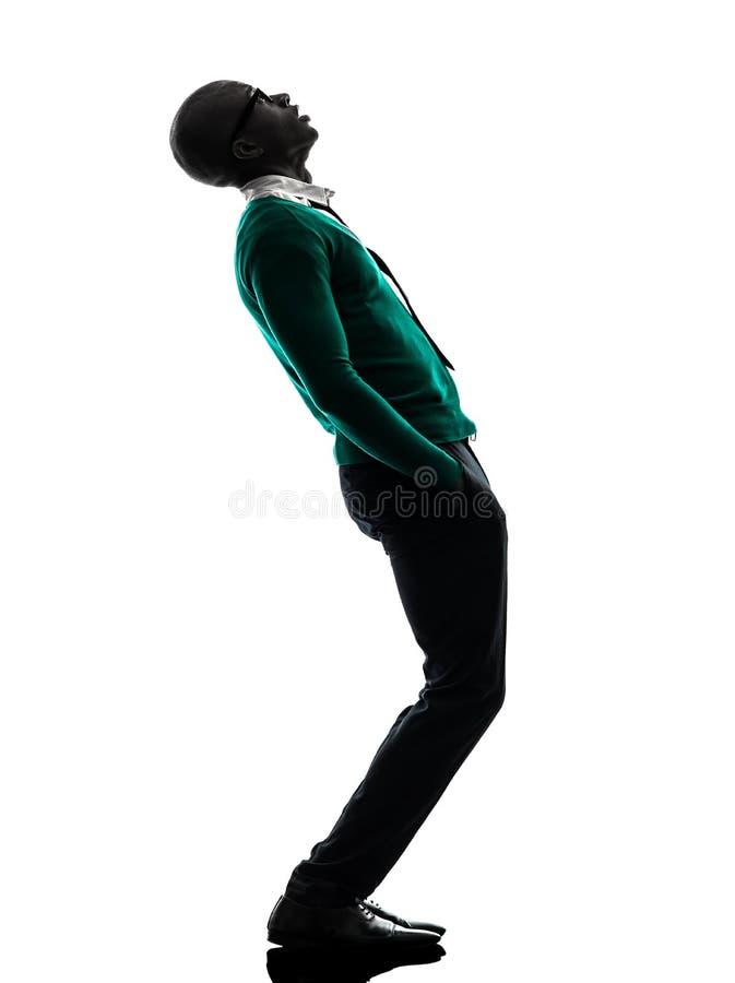 Αφρικανική στάση μαύρων που φαίνεται επάνω έκπληκτη σκιαγραφία στοκ φωτογραφία με δικαίωμα ελεύθερης χρήσης