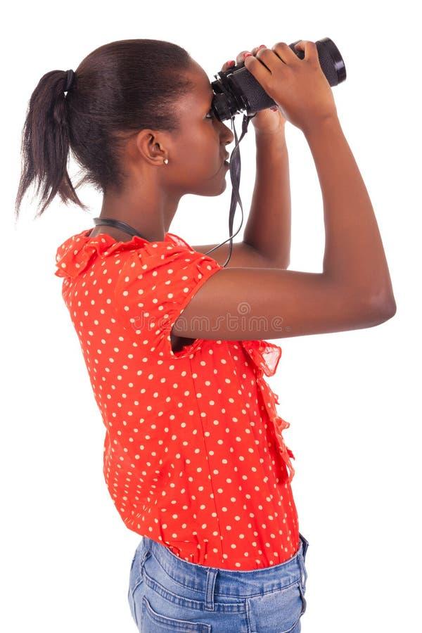 Αφροαμερικάνος που χρησιμοποιεί τις διόπτρες που απομονώνονται πέρα από το άσπρο υπόβαθρο στοκ εικόνα